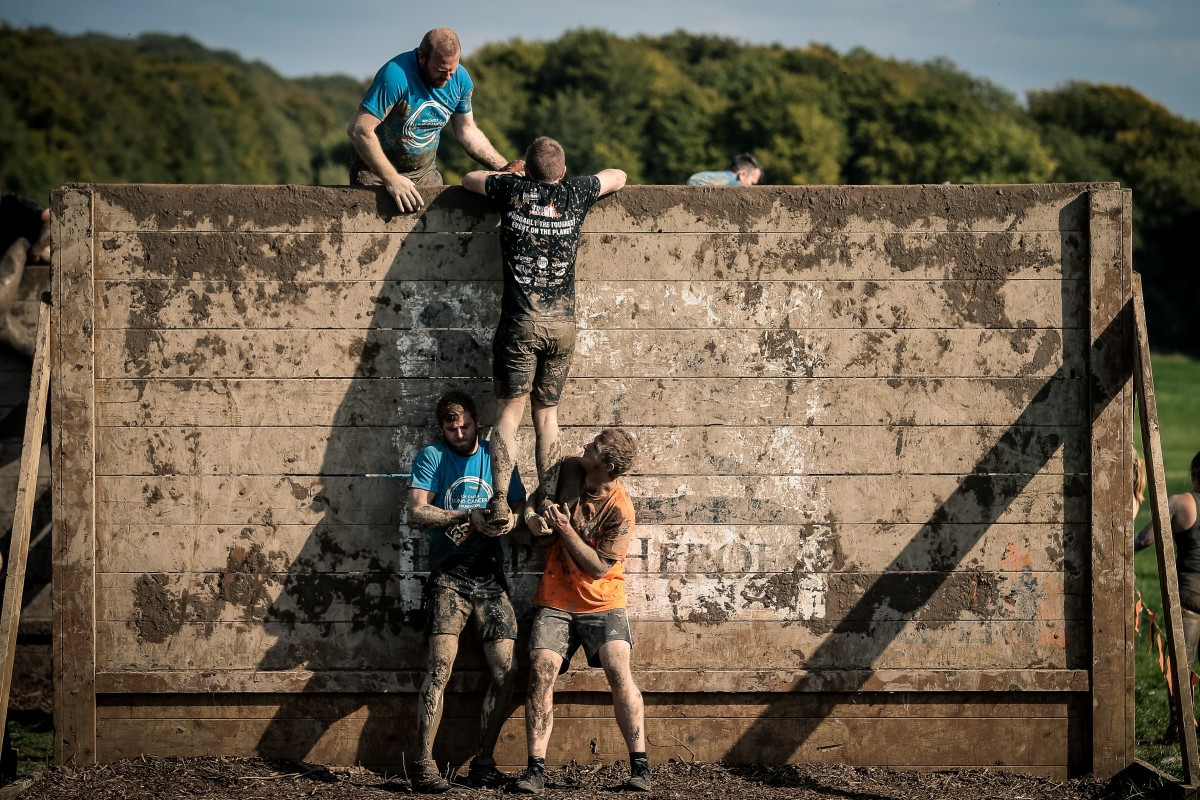 Tough Mudder Teamwork over obstacles
